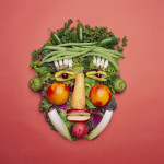 Veggies arranged to create a face